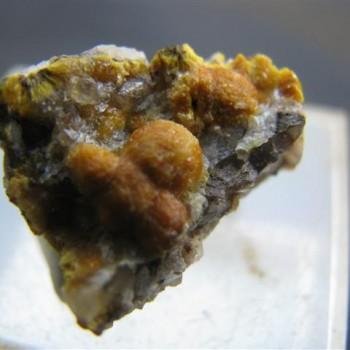 rhomboidal mineral specimen of boltwoodite